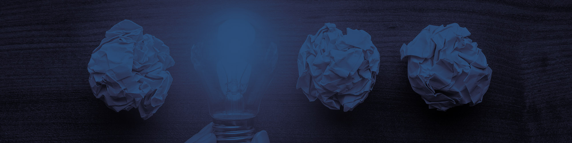 Light Bulb and Crumpled Paper